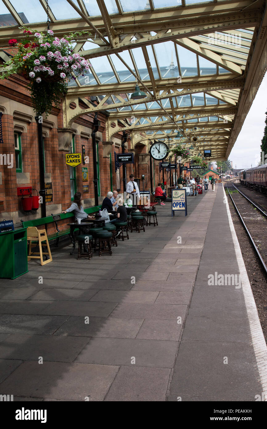 Platform One on Loughborough station heritage railway line with station master and passengers waiting for the arrival of a steam train - Stock Image
