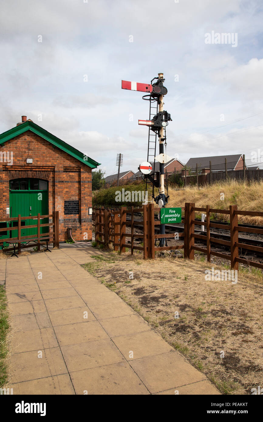 Semaphore railway signals at Loughborough station heritage railway line to control movements of railway traffic - Stock Image