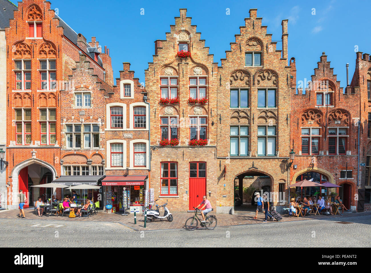 Cafes, restaurants and shops on Academiestraat near Het Tolhuis and Jan van Eyckplein, Bruges, Belgium - Stock Image