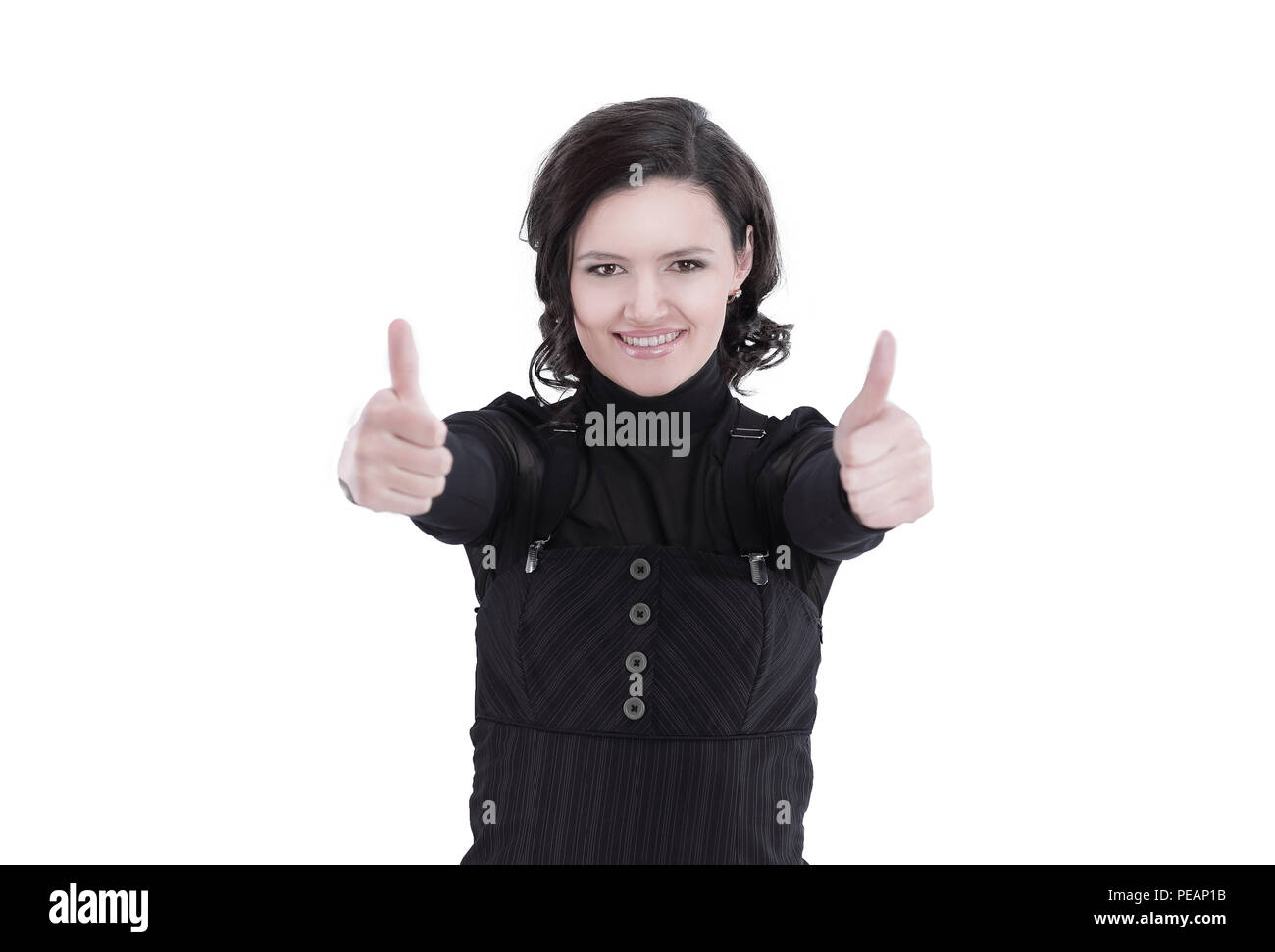 closeup.modern business woman showing thumb up. isolated on white background - Stock Image