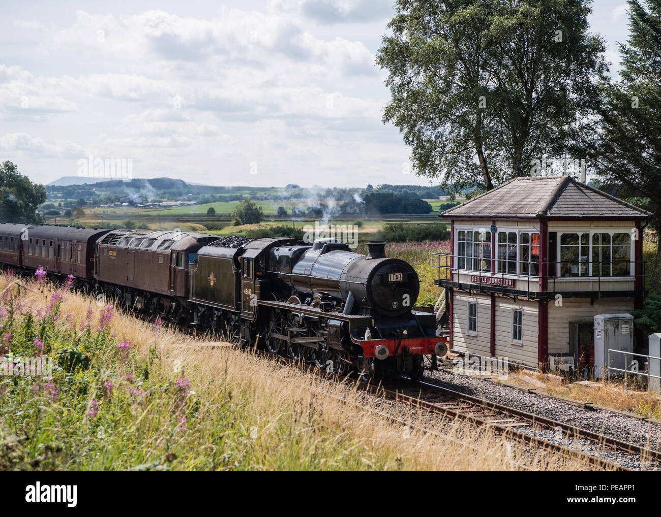 LMS Jubilee Class 5690 Leander at Settle Junction as 1T57 on 11 August 2018, 50 yrs after last steam-hauled passenger train. Original headboard - Stock Image