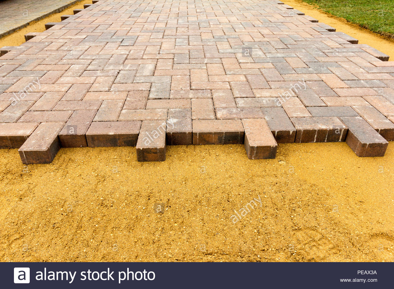 Newly laid block paving applied to a sharp sand base - Stock Image