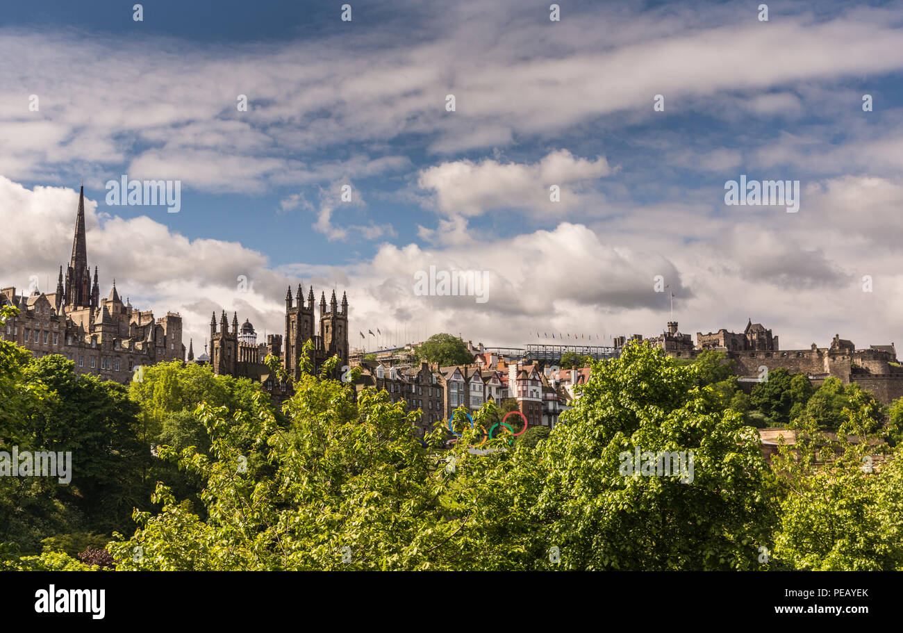 Edinburgh, Scotland, UK - June 13, 2012: Looking from Scott Monument to Market Street with from University of Edinburgh to Castle. Green foliage, Blue - Stock Image