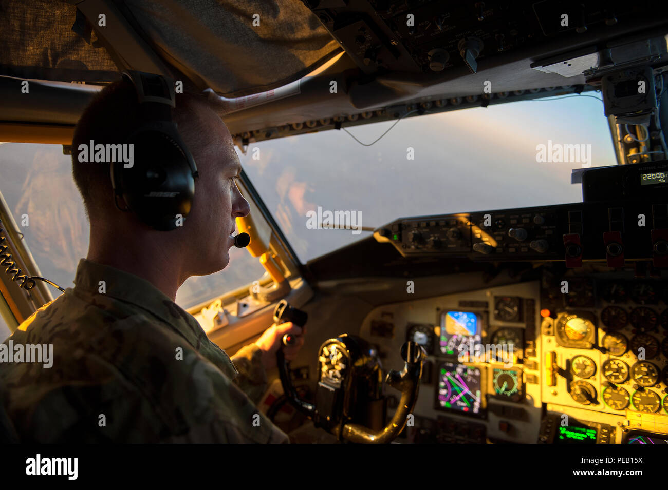 U.S. Air Force Capt. TJ Mahosky, 340th Expeditionary Air Refueling Squadron pilot, flies a KC-135 Stratotanker over Southwest Asia in support of Operation Inherent Resolve, Dec. 4, 2015. Capt. Mahosky is deployed from the 171st Air Refueling Wing in Pennsylvania. (U.S. Air Force photo by Tech. Sgt. Nathan Lipscomb) Stock Photo