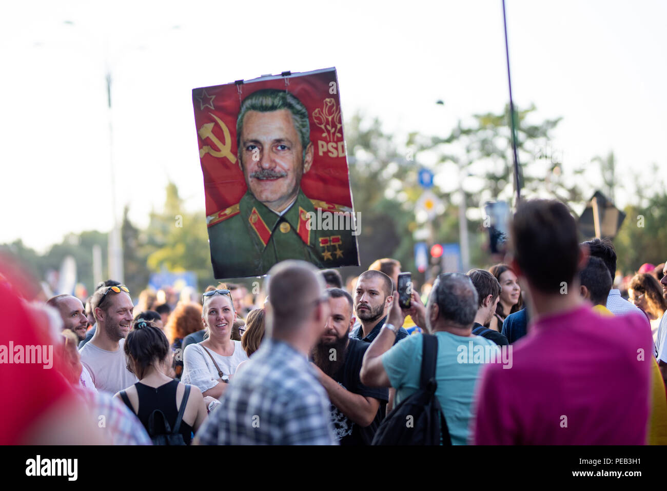 Romania, Bucharest - August 10, 2018: Protesters displaying an illustration of Liviu Dragnea as communist - Stock Image