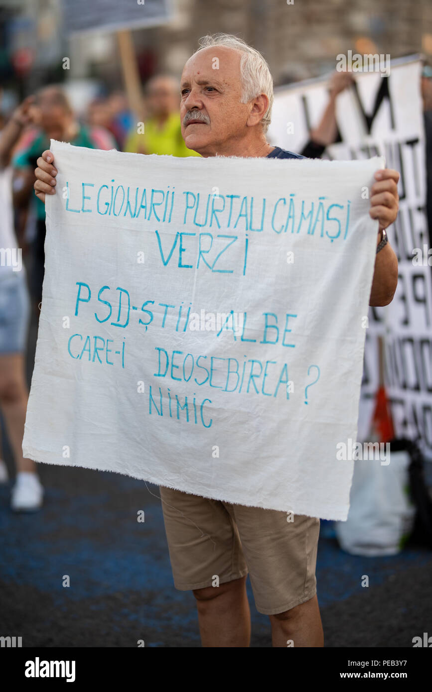 Romania, Bucharest - August 12, 2018: Old man protesting peacefully - Stock Image