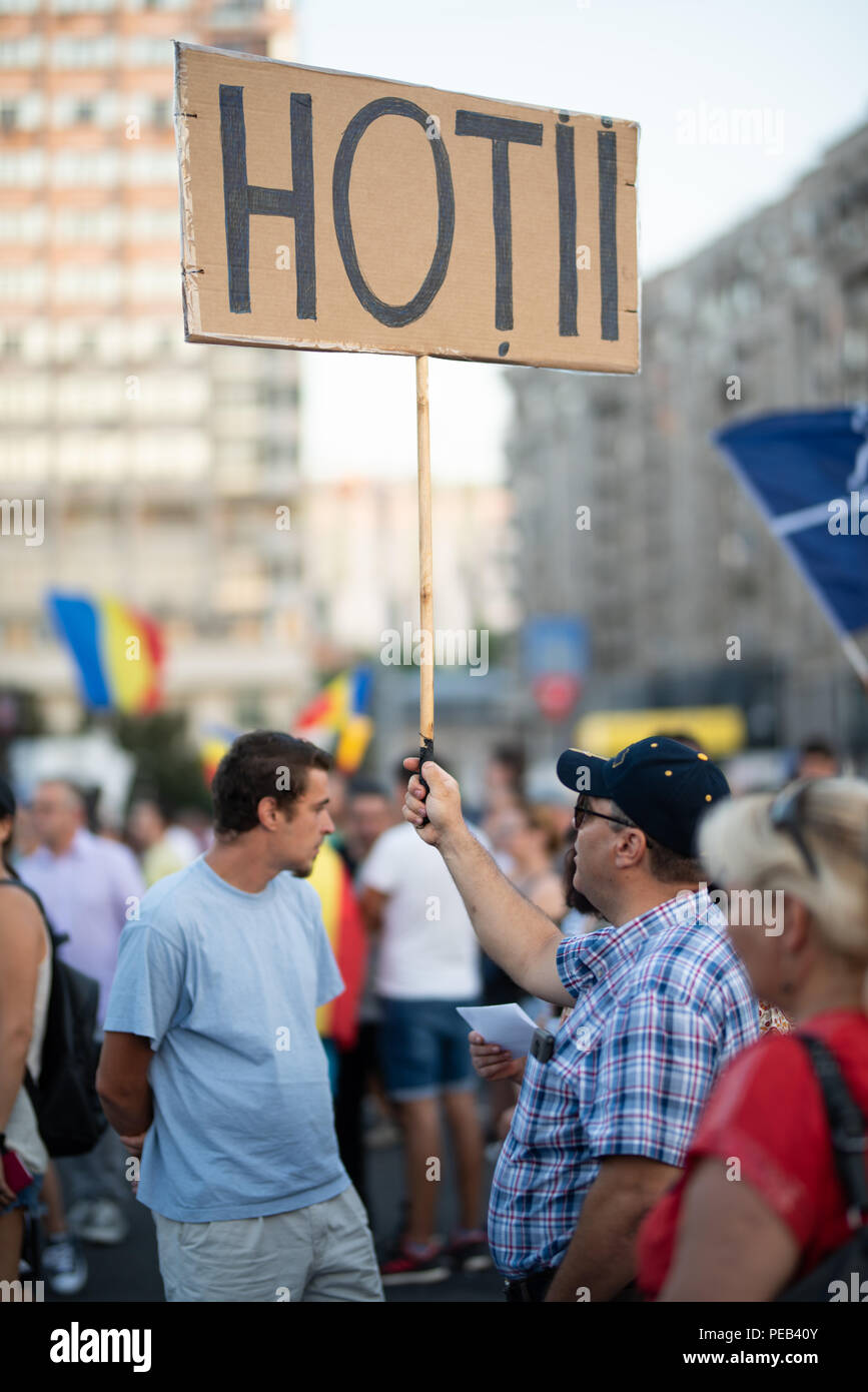 Romania, Bucharest - August 12, 2018: Man displaying sign displaying Thieves  - Stock Image