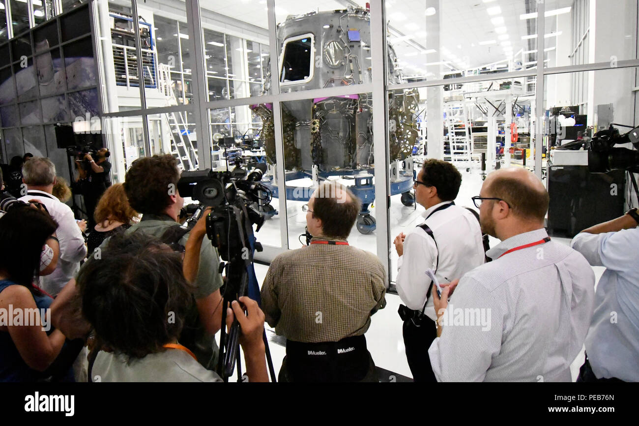 Hawthorne, California, USA. 13th August, 2018. Media gathers near SpaceX new dragon crew capsule being built during during a press conference with NASA Astronauts Monday. They will be the first to go up in the new Commercial Crew Dragon capsule to the ISS (International Space Station).Photo by Gene Blevins/LA DailyNews/SCNG/ZumaPress Credit: Gene Blevins/ZUMA Wire/Alamy Live News - Stock Image