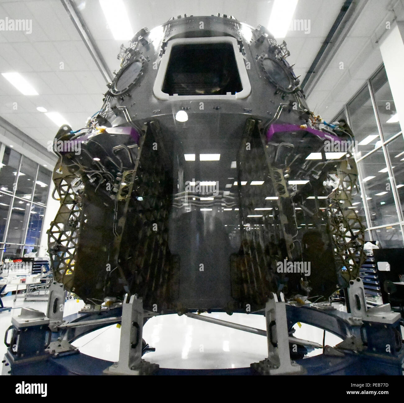 Hawthorne, California, USA. 13th August, 2018. SpaceX displays one of a few new dragon crew capsule being built during a press conference with NASA Astronauts Monday. They will be the first to go up in the new Commercial Crew Dragon capsule to the ISS (International Space Station).Photo by Gene Blevins/LA DailyNews/SCNG/ZumaPress Credit: Gene Blevins/ZUMA Wire/Alamy Live News - Stock Image