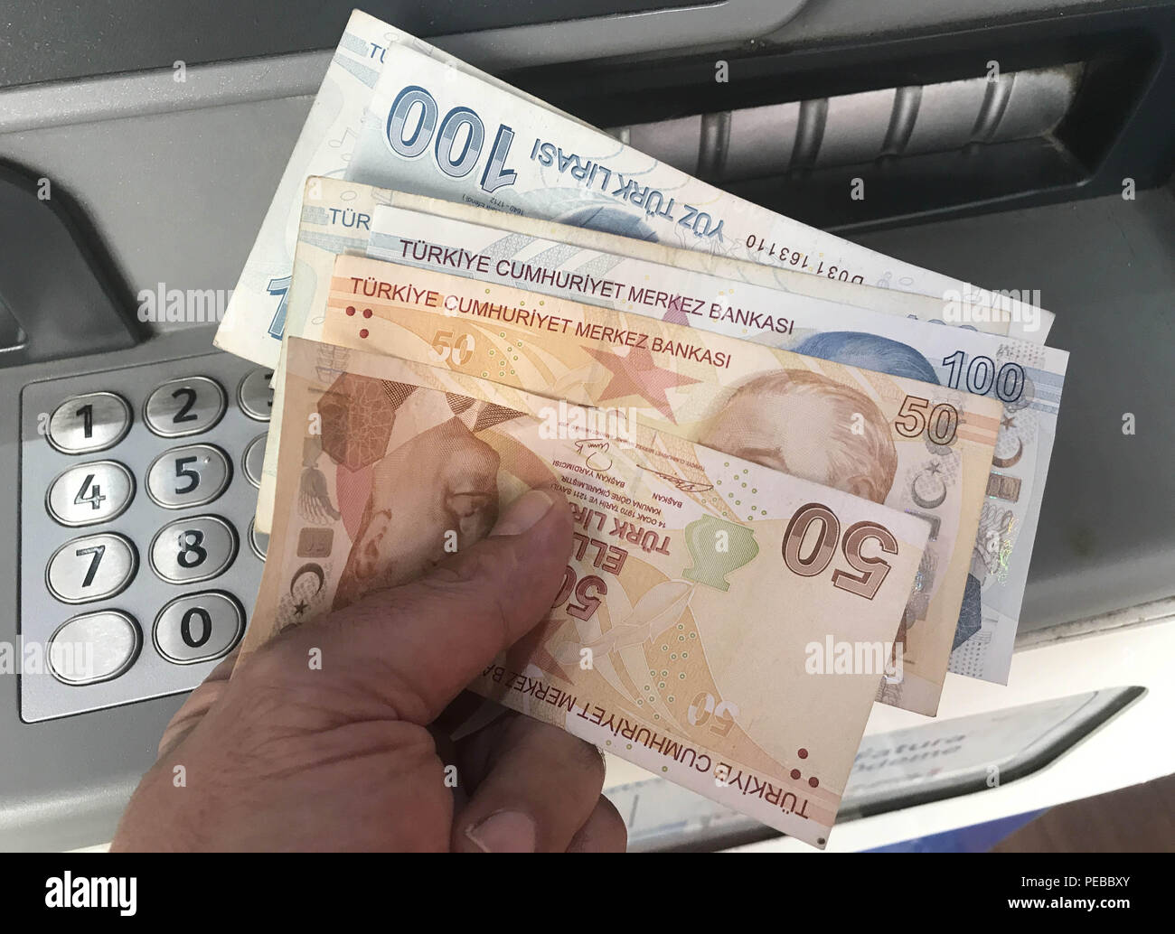 (180814) -- ISTANBUL, Aug. 14, 2018 (Xinhua) -- A tourist company employee counts Turkish lira in Istanbul, Turkey, on Aug. 14, 2018. Turkish President Recep Tayyip Erdogan announced Tuesday to boycott U.S. electronic products amid an ongoing and deepening rift between the two NATO allies over a number of issues. Erdogan reiterated that the recent plunge of Turkish lira and stocks was caused by an economic attack by U.S. President Donald Trump and his administration. The Turkish lira has recovered against the dollar and euro early Tuesday, up more than 4.5 percent at 6.57 lira against one U.S Stock Photo