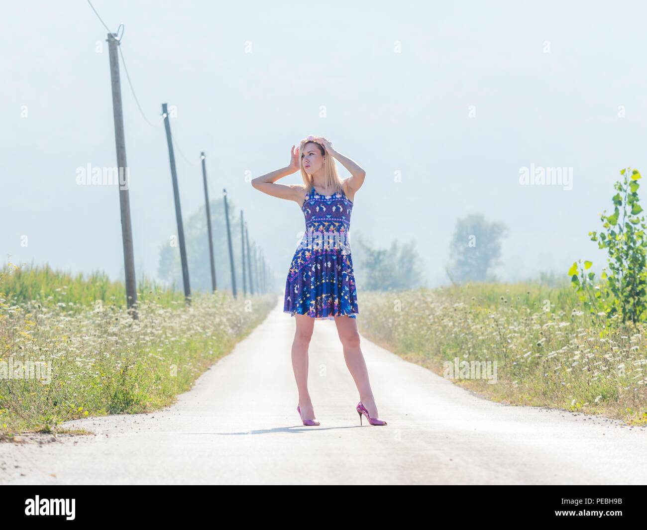 Sunlight mid-day 20s twenties attractive adult young woman outdoors by foot feet traveler traveling Stock Photo