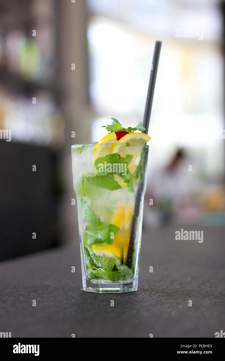 Mojito cocktail in a glass on the long bar counter - Stock Image