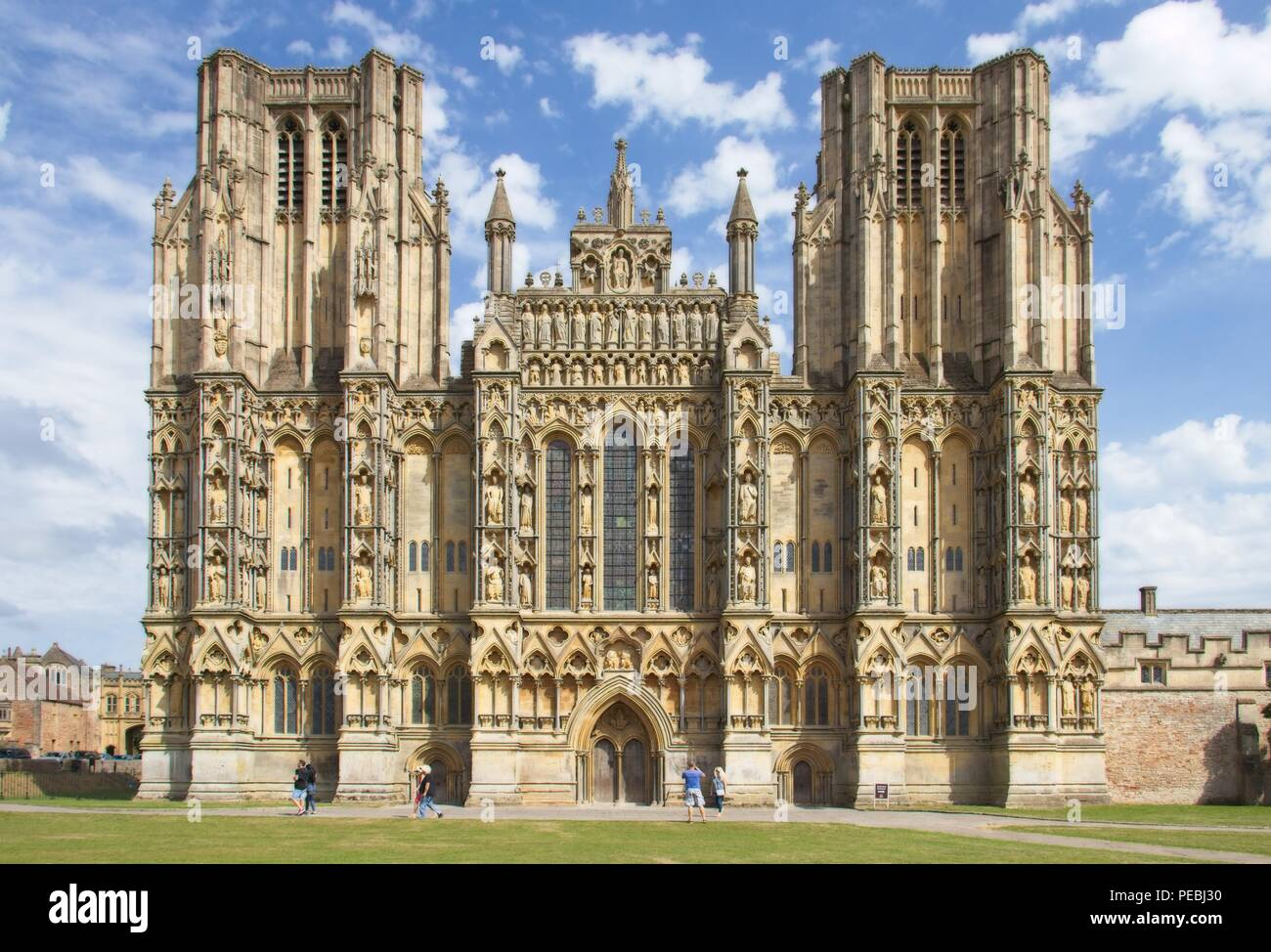 Wells Cathedral, West Front, Blue sky with fluffy clouds. - Stock Image