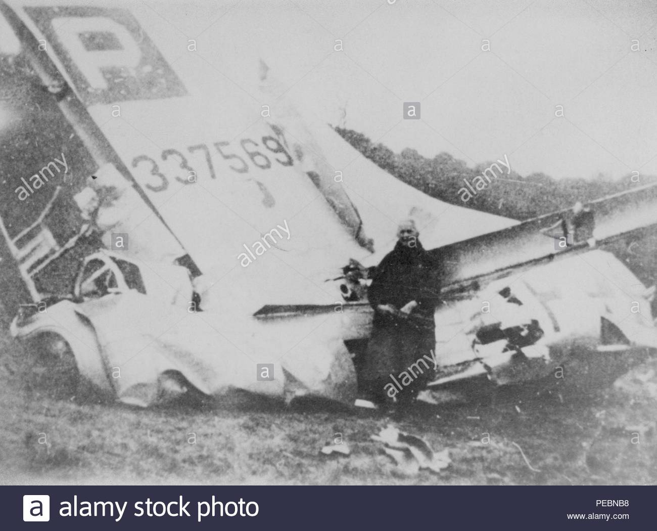 An unknown man poses in front of a downed B-17 Flying Fortress, tail number 4337569, following a dogfight which occurred, Dec. 24, 1944. The aircraft's crew included 1st Lt. Vernal Cuno Becker, the tail gunner on the mission, and great-uncle of current U.S. Air Force Chief Master Sgt. James McCloskey. (Courtesy photo) Stock Photo