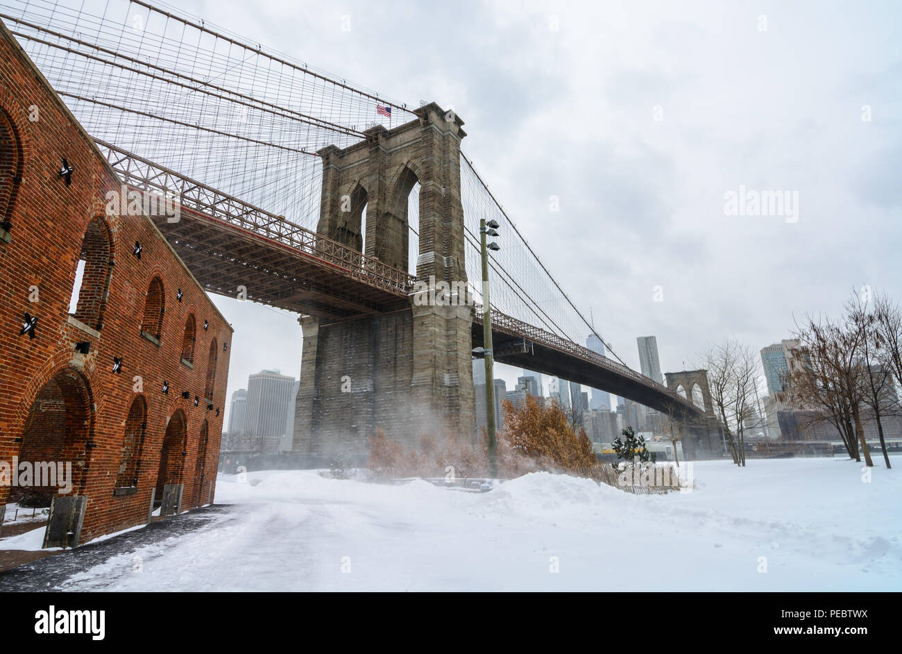 The Brooklyn Bridge in DUMBO, NYC just after winter storm Grayson hit in January 2018. - Stock Image