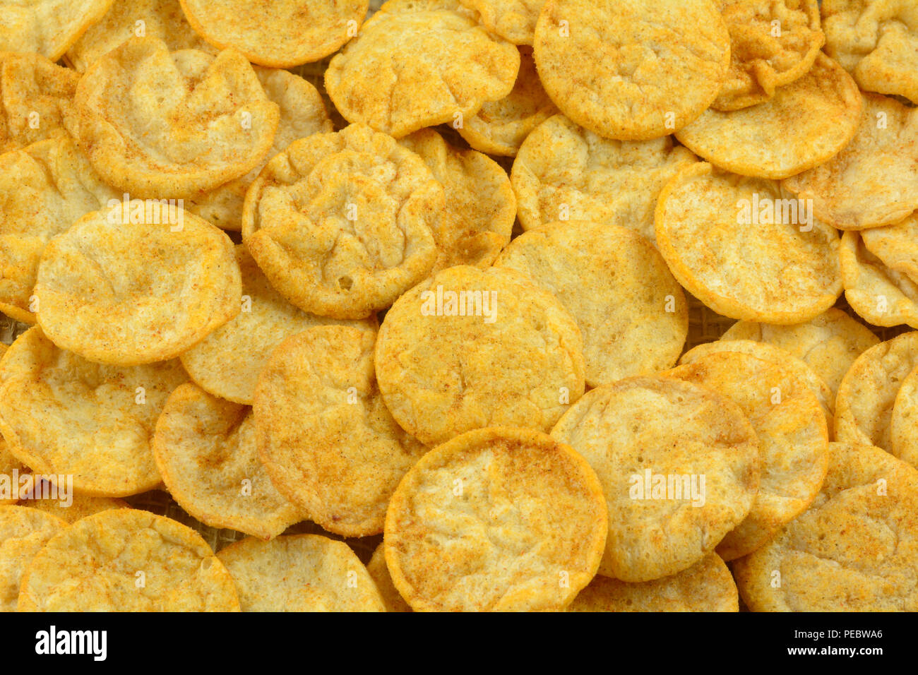 Close up of crispy healthy hummus and basil chips as healthy alternative - Stock Image