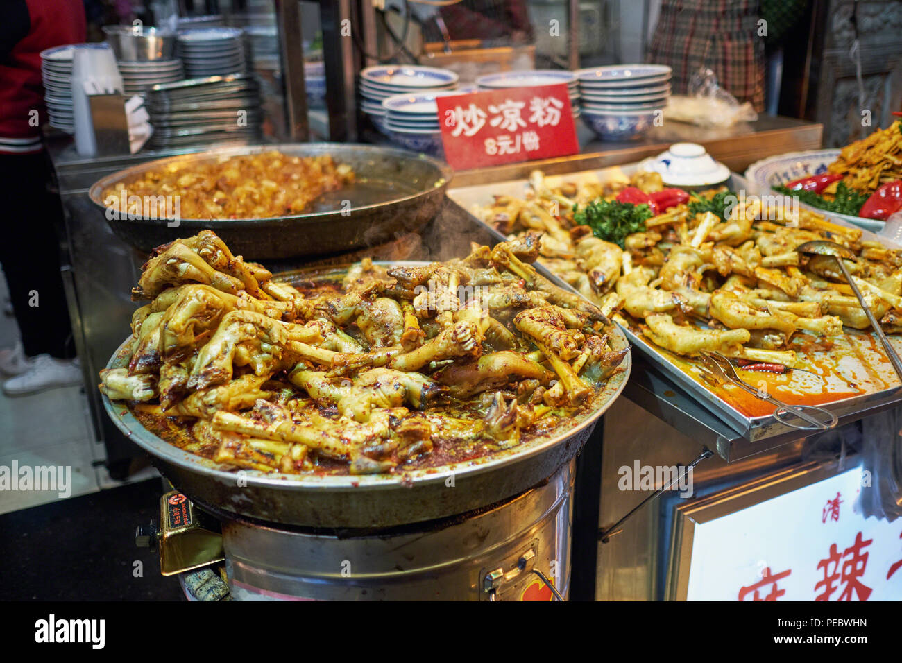 Cooked Goat Hoof and Feet in a Street Food Market, Muslim Street, Xi/an, China - Stock Image