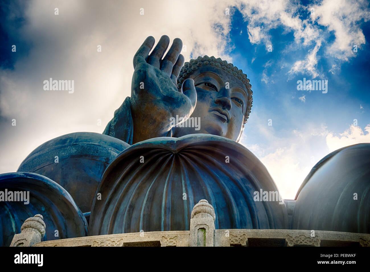 Low Angle View of the Tian Tan Buddha Statue, Enthroned on a Lotus Flower, Ngong Ping, Lantau Island, Hong Kong, China - Stock Image