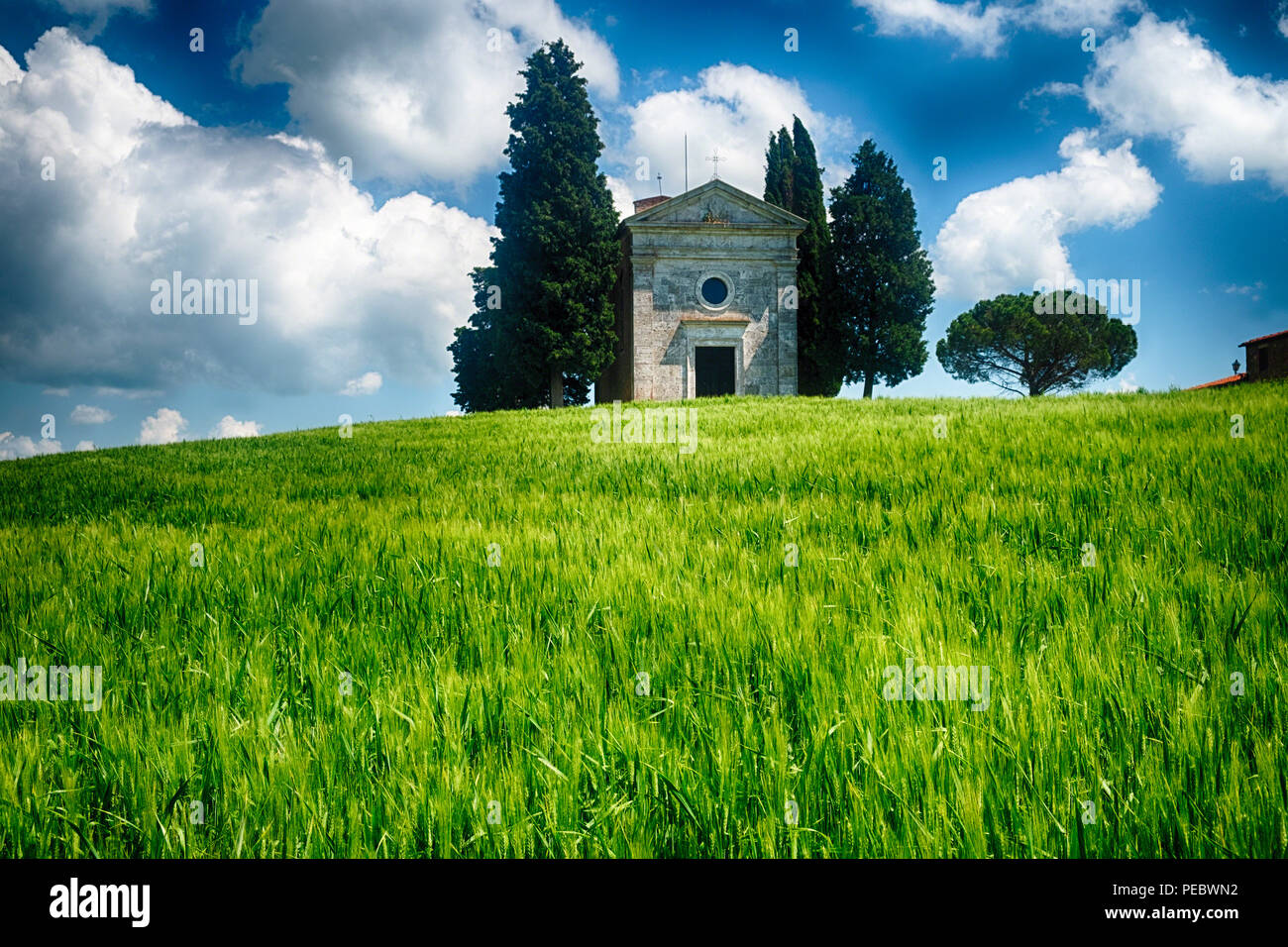 Chapel of The Madonna Di Vitaleta in a Wheat Field with Cypress Trees, San Quirico D'Orcia, Tuscany, Italy - Stock Image