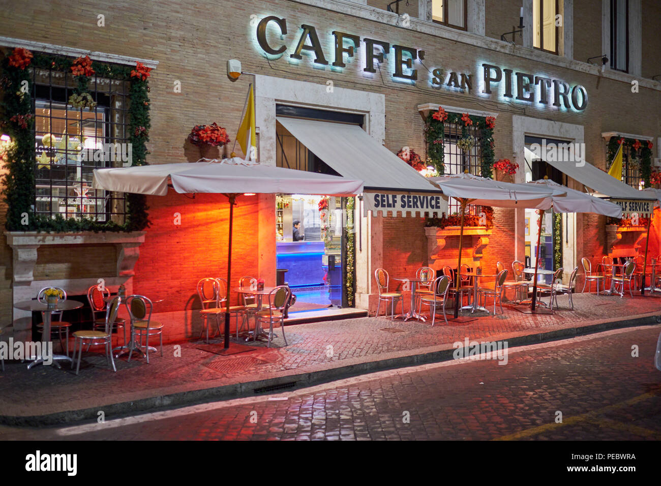 Curbside Cafe Near the Vatican at Night During Holiday Season, Rome, Italy - Stock Image