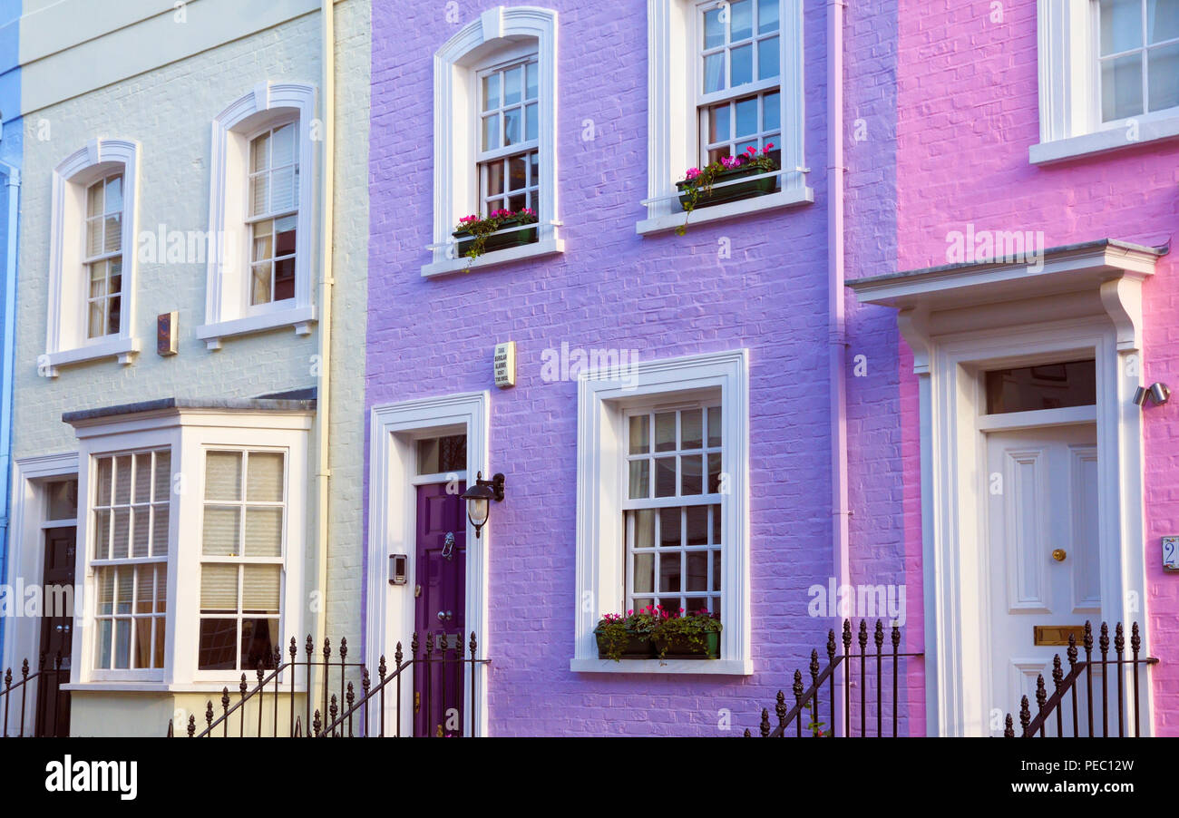 A row of pretty pastel Georgian houses on Bywater Street, off the Kings Road, Chelsea, London SW3, England, UK Stock Photo