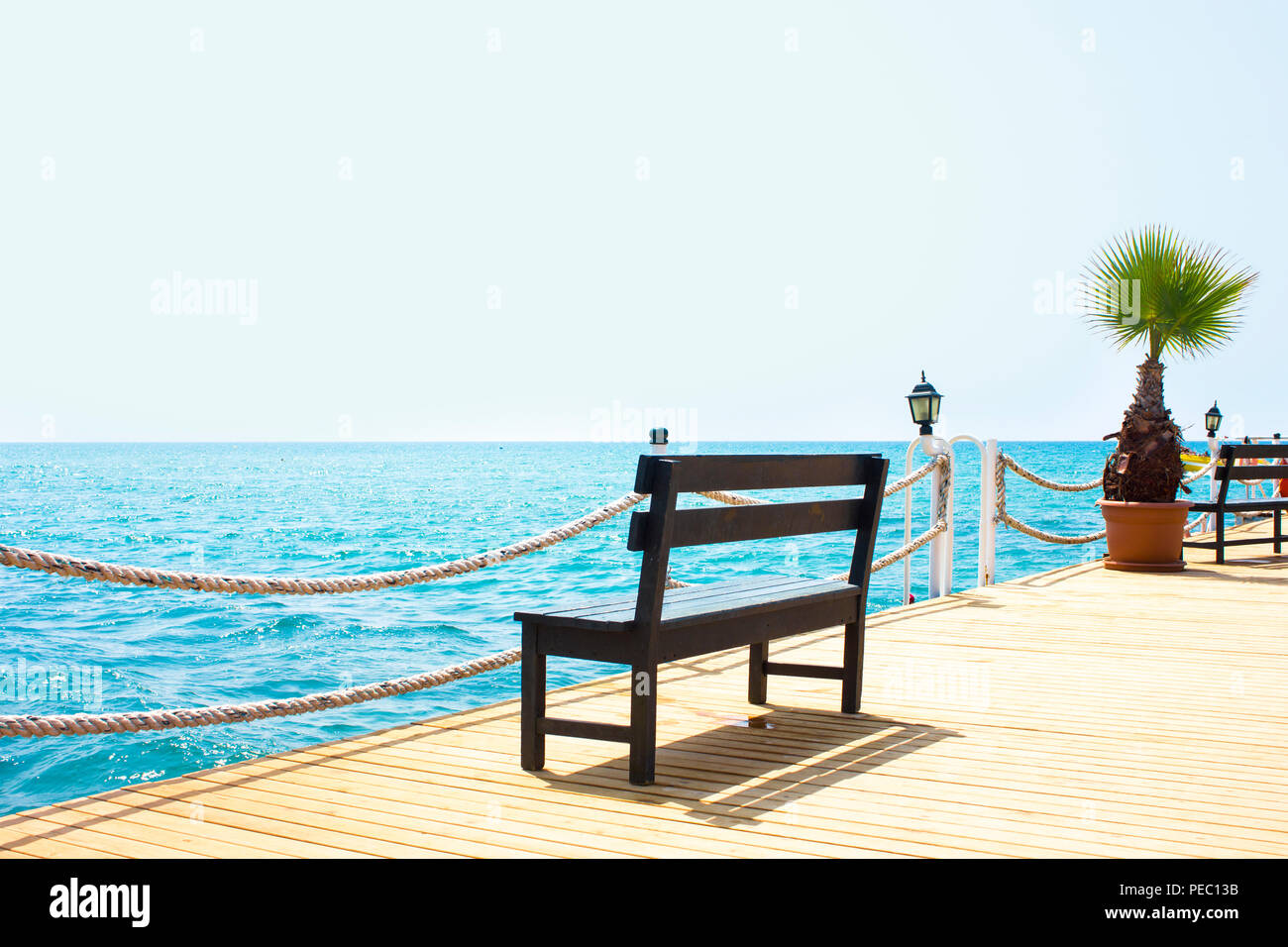 Enjoyable Wooden Bench On The Pier By Sea With A Boat Stock Photo Evergreenethics Interior Chair Design Evergreenethicsorg