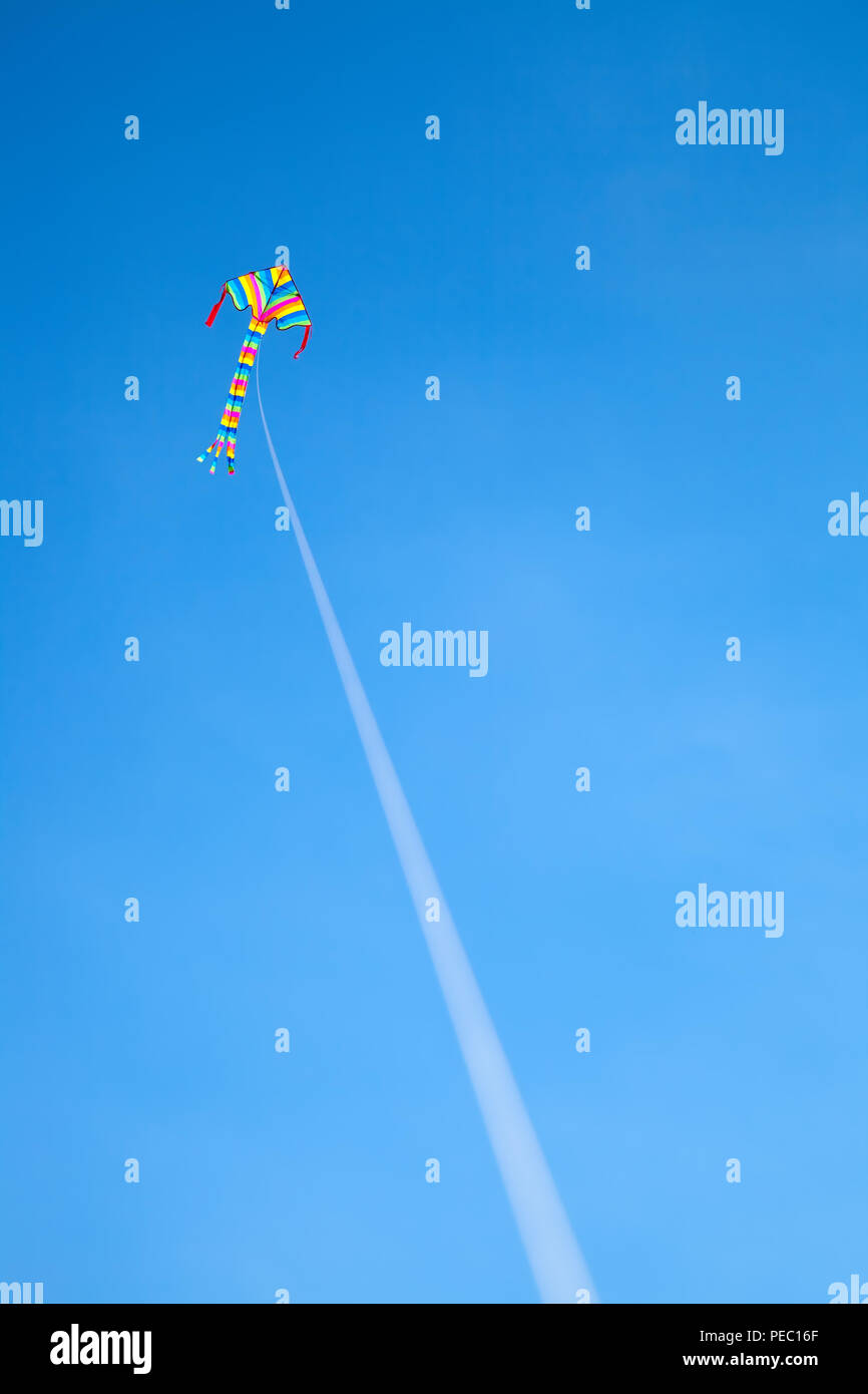colorful kite flying in the wind - Stock Image