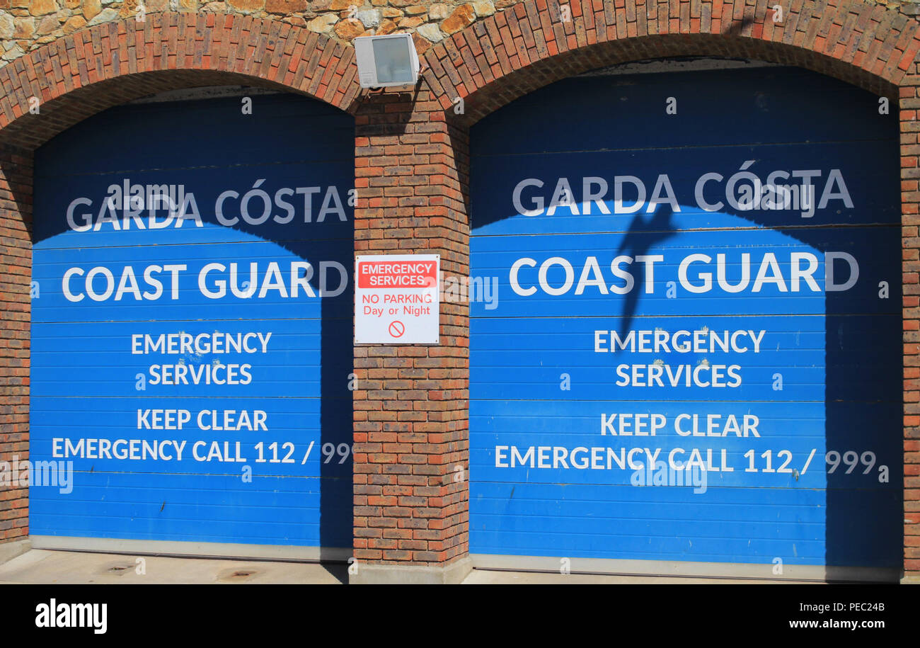 The entrance to the Irish Coast Guard Depot in Howth, Co. Dublin, Ireland. The notice includes emergency telephone numbers and warnings to keep  clear. - Stock Image