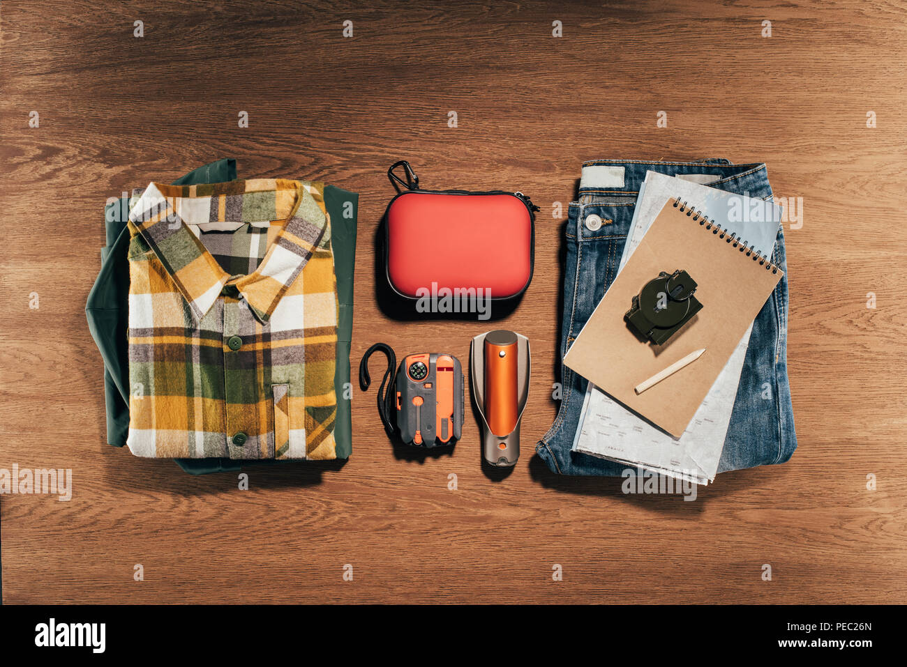 top view of travel items set on wooden table - Stock Image