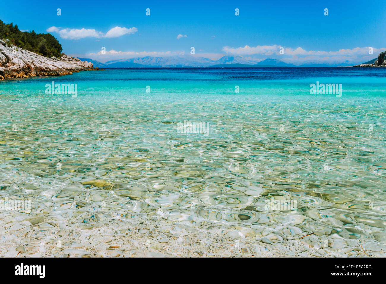 Dafnoudi beach in Kefalonia, Greece. Remote lagoon with pure clean turquoise sea water, white rocks and cypress trees - Stock Image