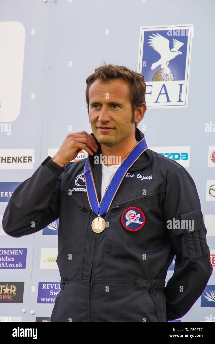 Eric Vazeille, British pilot, with bronze medal on the podium having finished third in the freestyle competition at World Aerobatic Championships - Stock Image