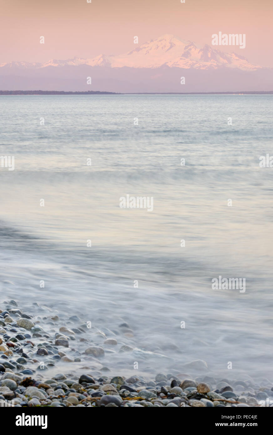 Mt Baker, Boundary Bay. The beach in Point Roberts, Washington State, looking out across Georgia Strait. USA. Stock Photo