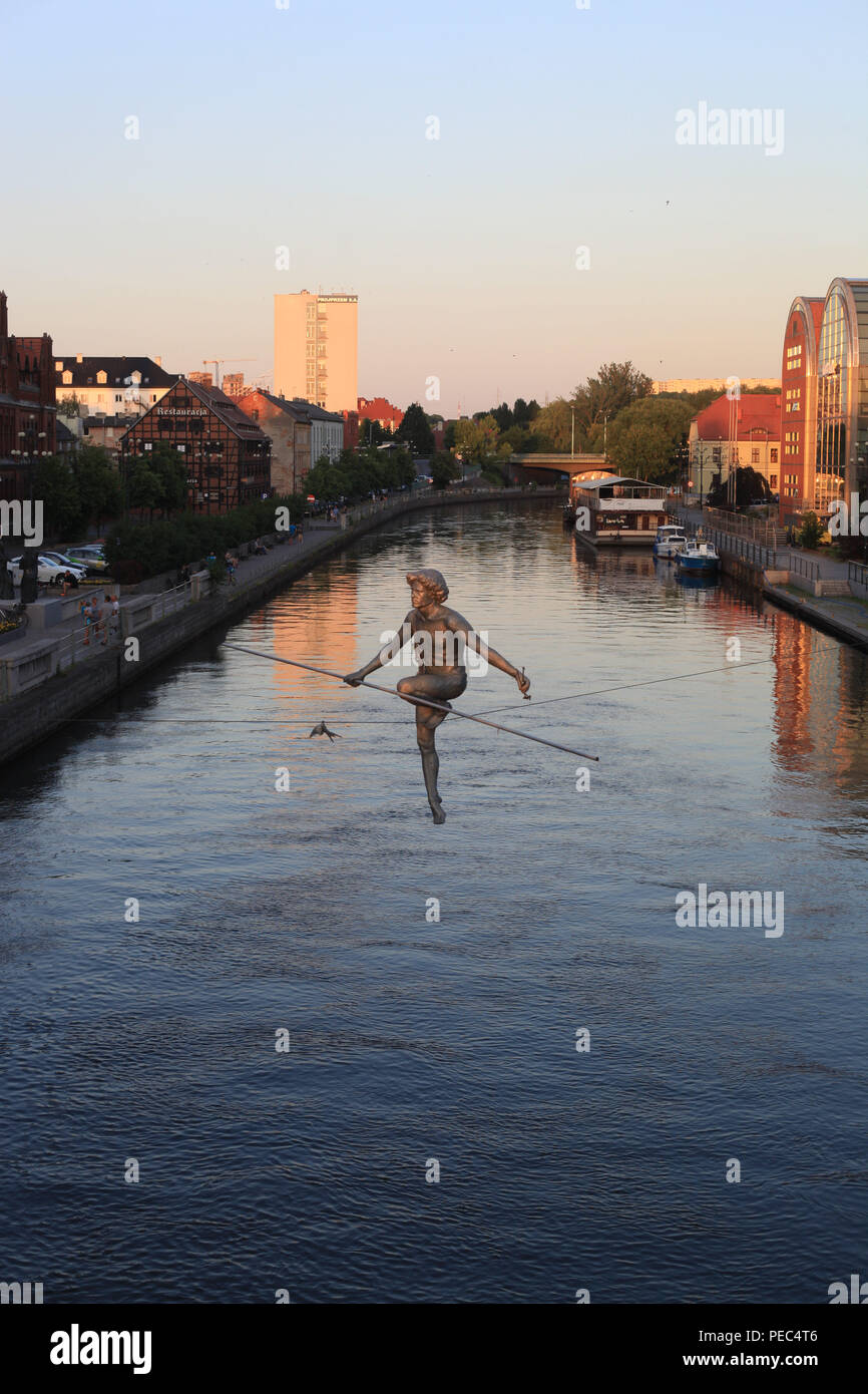 Man Crossing the River Statue In Bydgoszcz, Poland - Stock Photo