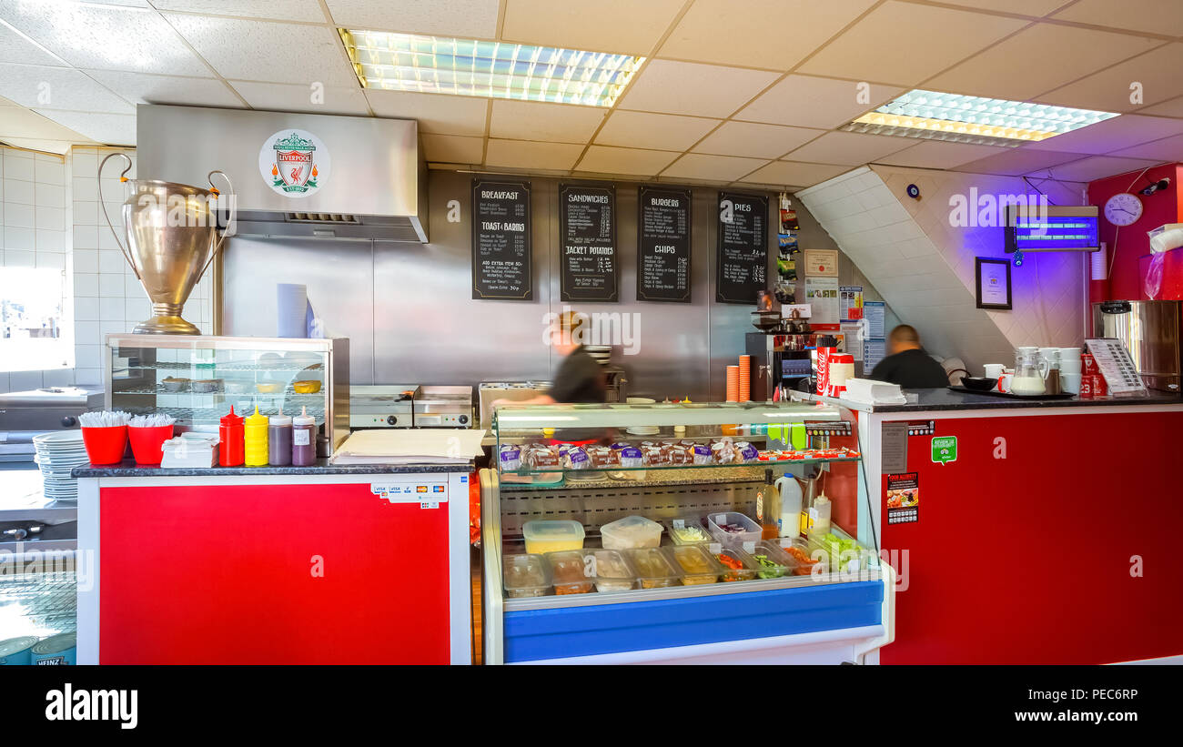 LIVERPOOL, UK - MAY 17 2018: Georgie Porgy a small cafe on Walton Breck Road in front of Anfield stadium serves breakfasts, jacket potatoes, sandwiche - Stock Image