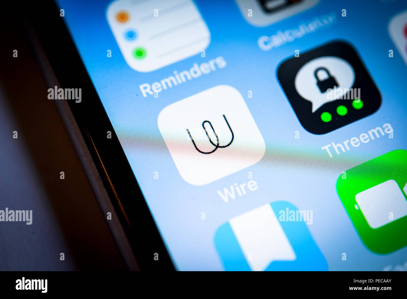 Wire, Threema, secure messenger app icon on iPhone, iOS, smartphone screen, display, close-up, detail, Germany - Stock Image
