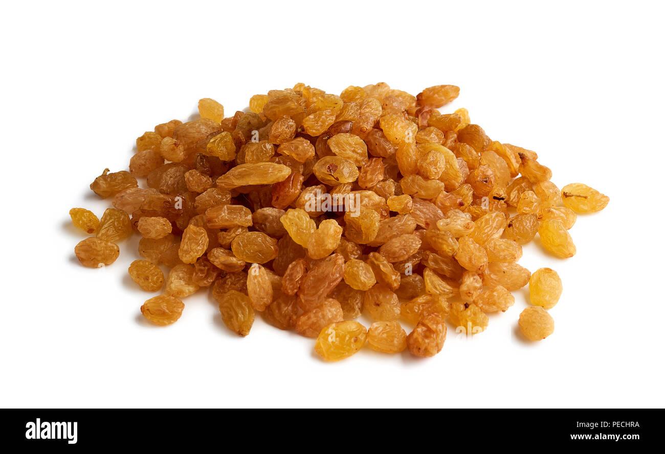 Heap of yellow raisins isolated on white background - Stock Image