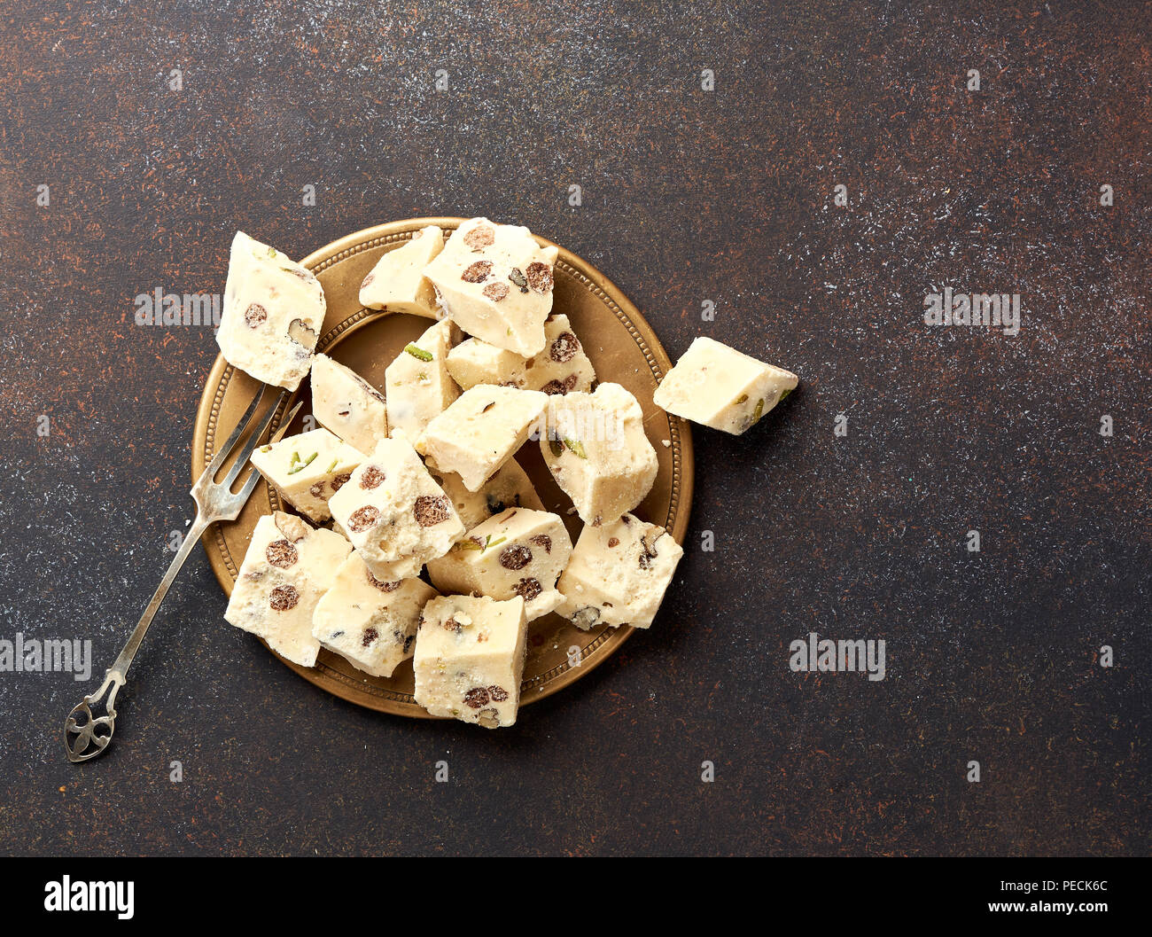 Eastern delicacy. Halva, sweetness, dessert on brown background. - Stock Image