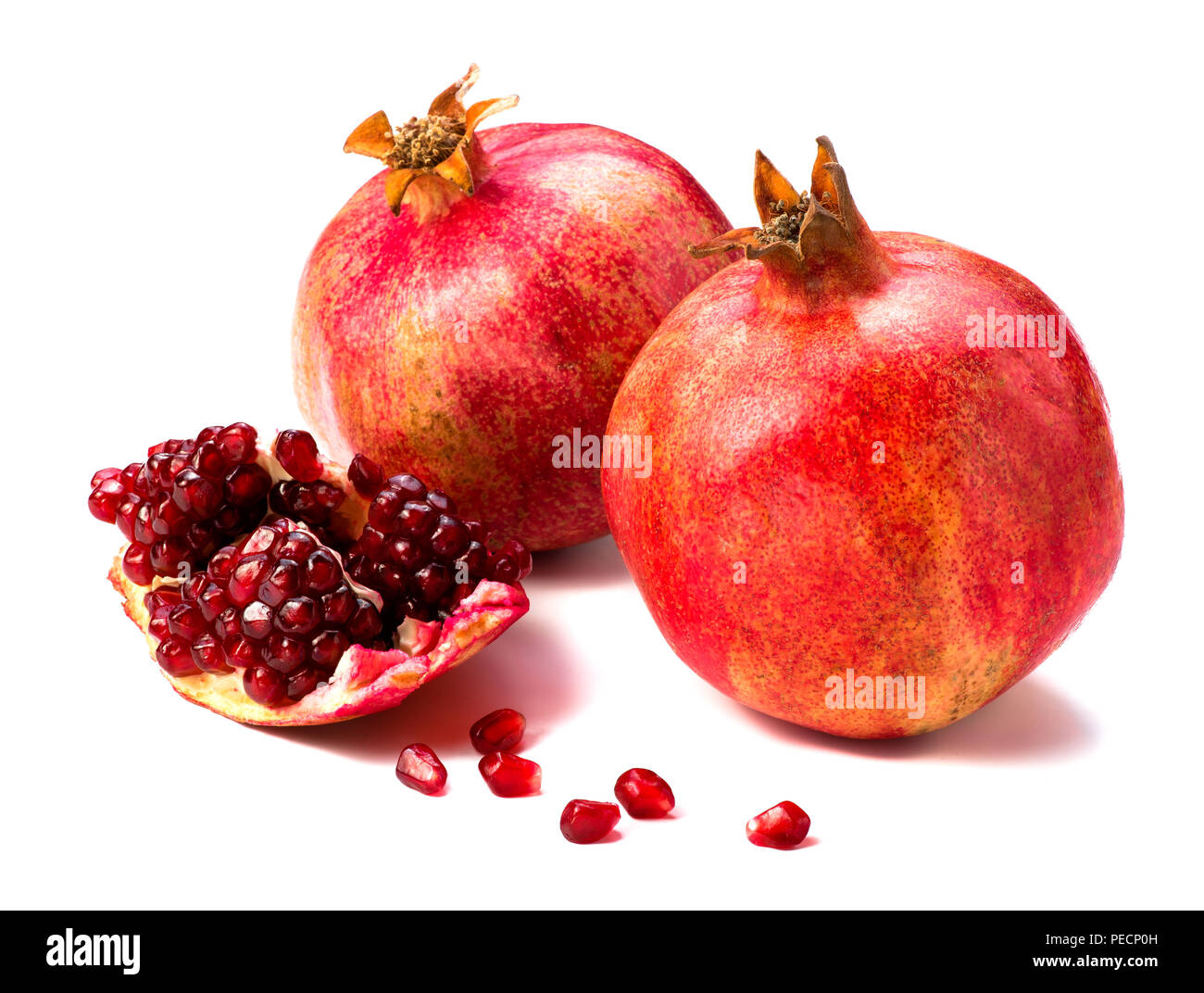 Pomegranate fruit isolated on white background. Slice. - Stock Image