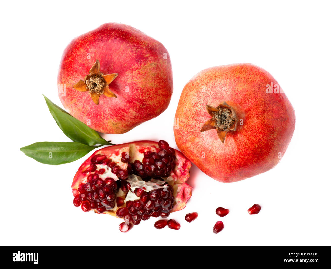 Pomegranate fruit isolated on white background. Slice. Top view. - Stock Image