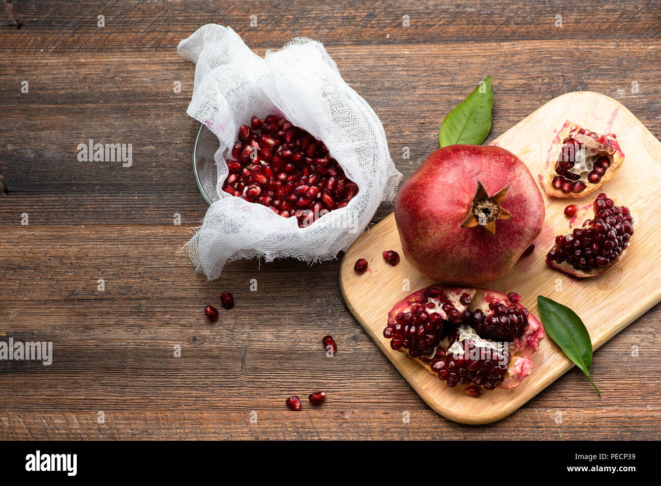 Pomegranate fruits with grains on wooden table. Top view. Make  juice. - Stock Image
