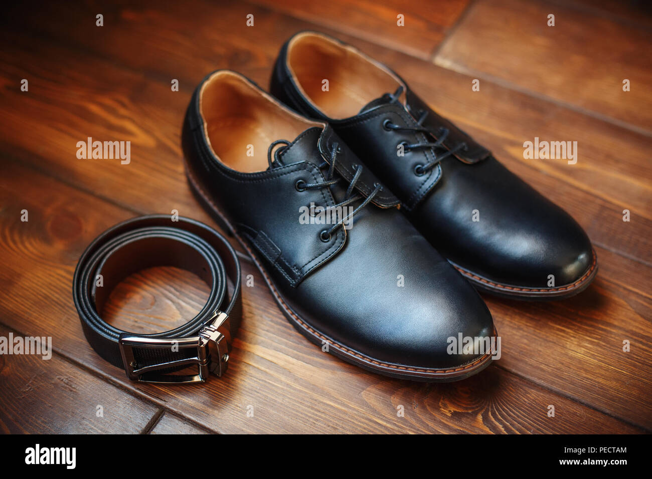 Black leather male shoes and belt on