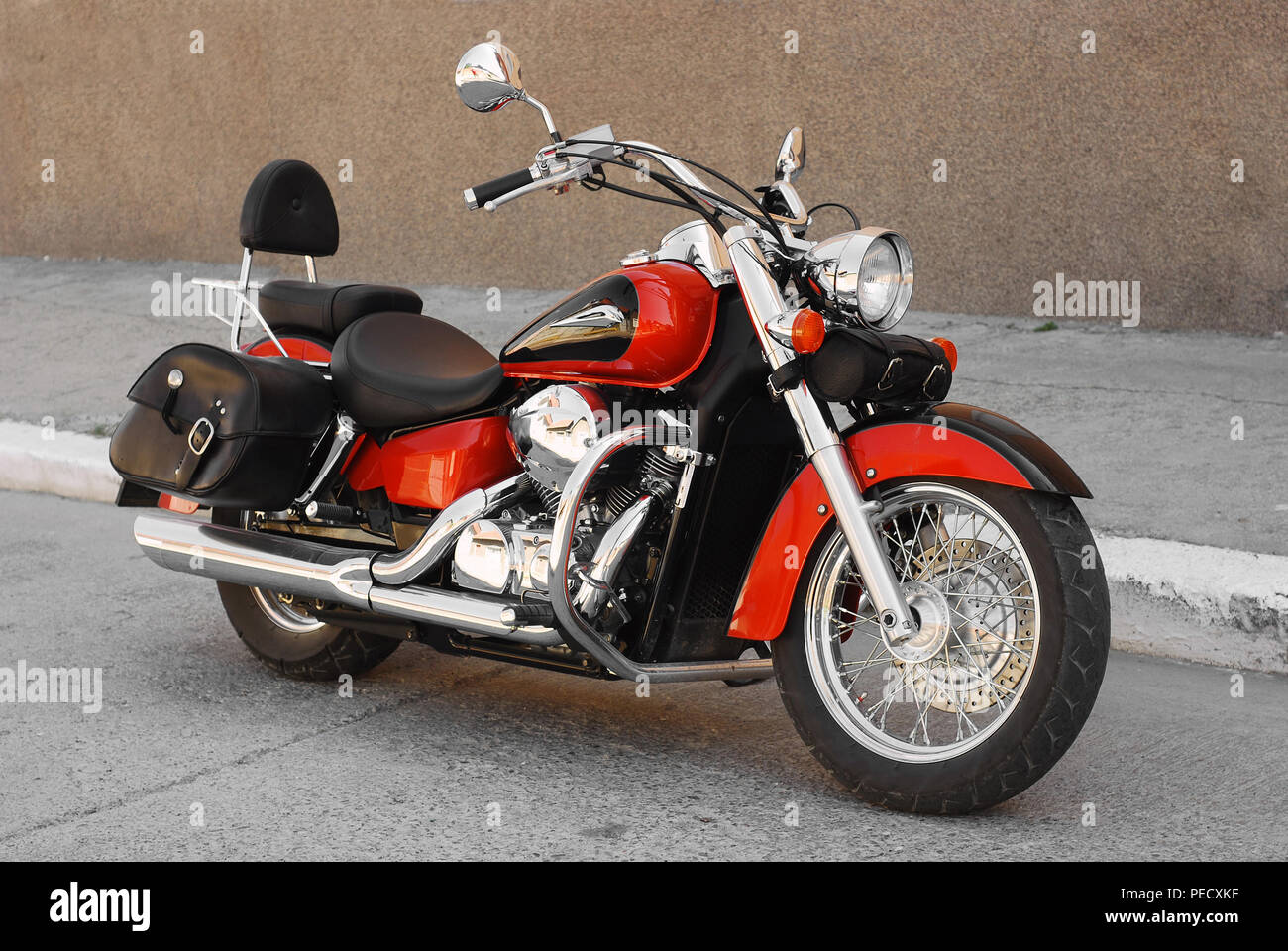 chopper motorcycle parked on the road - Stock Image