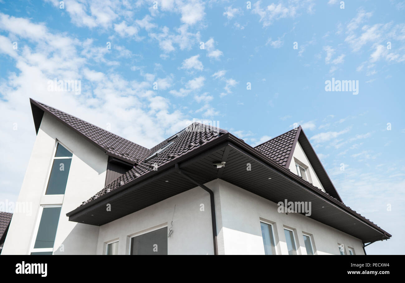 Modern Roof Covered With Tile Effect Pvc Coated Brown Metal Roof Sheets Stock Photo Alamy