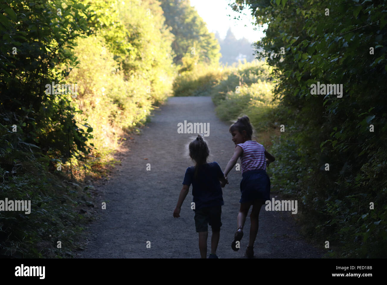Two friends running - Stock Image