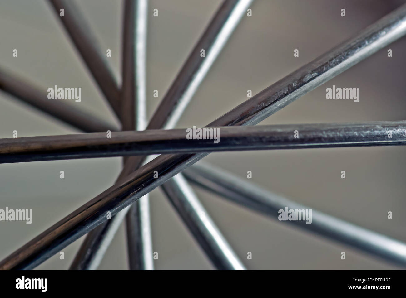 The nodal point of a wire whisk where the blades intersect and cross. - Stock Image