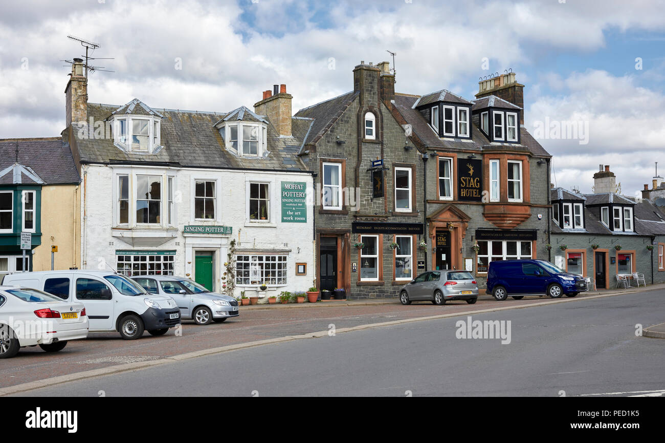 Early morning and the Top of Moffat high Street with The Stag Hotel, The Moffat Pottery and The Singing Potter. Scotland - Stock Image