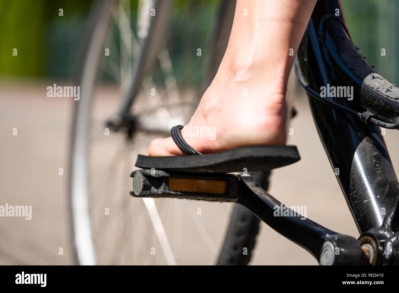 c88a98bfefdb A girl is riding her bike with flip flops Stock Photo  215418140 - Alamy