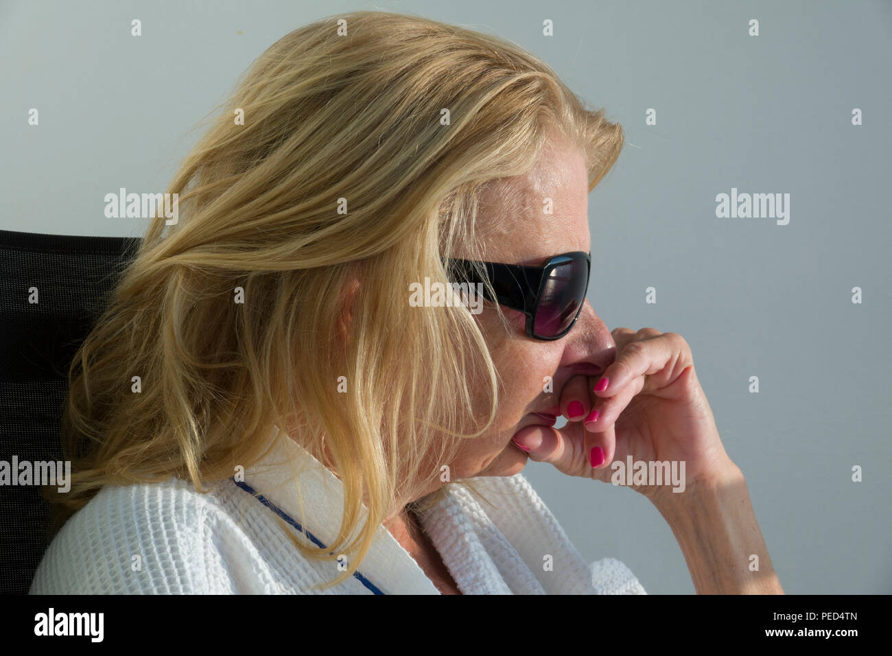 Close up of an Adult female thinking in a pensive pose - Stock Image