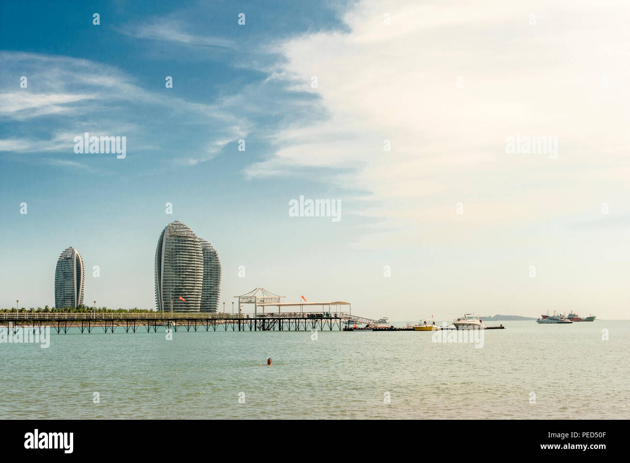 The innovative architecture of Phoenix Island seen from Sanya's city beach - Stock Image