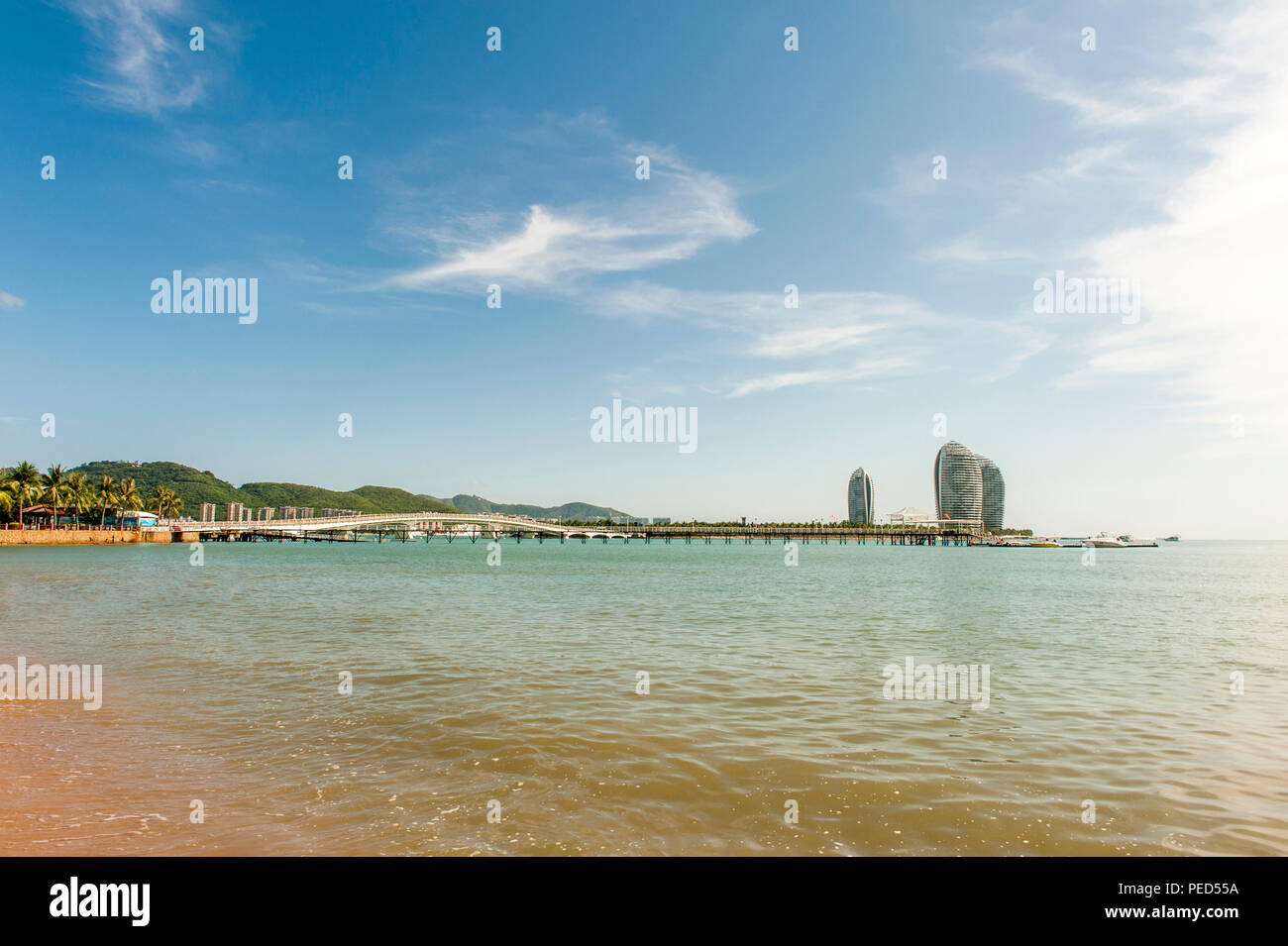 View of Phoenix Island from the public beach at Sanya, China - Stock Image